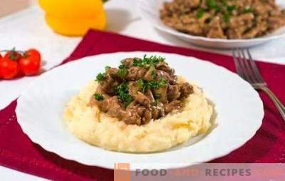 Beef stroganoff in a slow cooker - a restaurant dish. Tomato and creamy version of beef stroganoff in a slow cooker