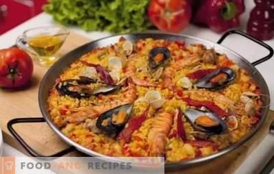Paella mit Meeresfrüchten - Plov im spanischen Stil. Paella mit Meeresfrüchten und Bohnen, Mais, Erbsen, Fisch