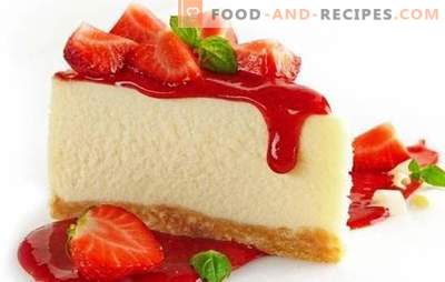 Table decoration - colorful cheesecake with strawberries. Dessert cheesecakes with strawberries: hot and cold cooking
