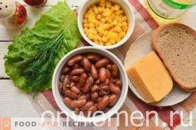Salad with beans, crackers, corn and cheese