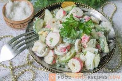 Salads with crab sticks and cucumber