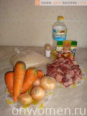 Pilaf of pork ribs in a cauldron