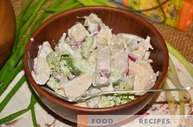 Salad with chicken, squids and cucumber
