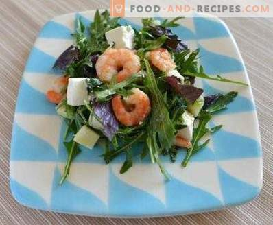Salads with shrimps and arugula