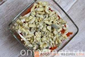 Layered salad with sprats