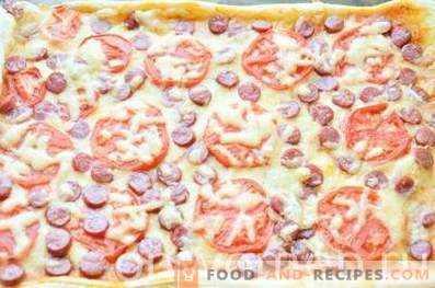 Pizza with hunting sausages and tomatoes