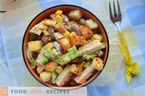 Salad with beans, crackers, corn and chicken