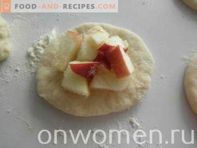 Fresh pies with apples in the oven