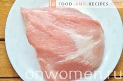 Baked pork ham in foil in the oven