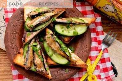 Sandwiches with sprats and fresh cucumber
