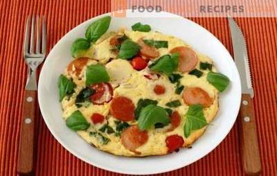 Simple omelets with tomatoes and sausage - a tradition! In the oven or in the pan - omelets with tomatoes and sausage