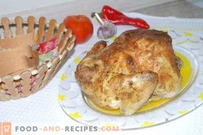 Chicken baked in foil in the oven entirely