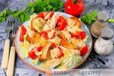 Caesar salad with chicken, Chinese cabbage, crackers and tomatoes