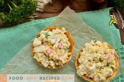 Tartlets with crab sticks, cheese and egg